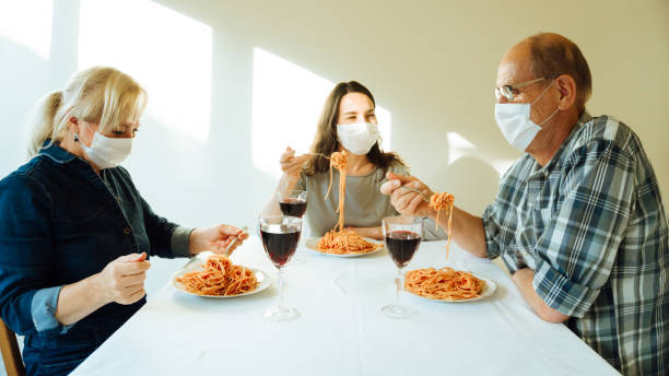 People dining with masks