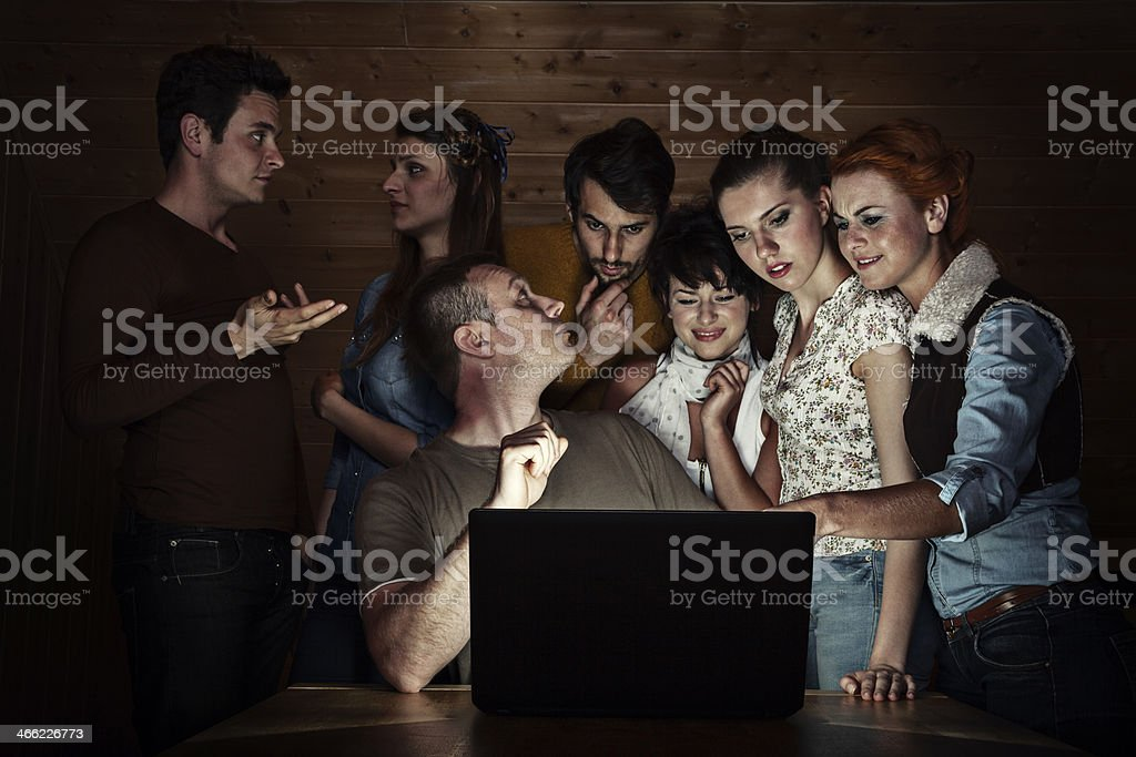 People Discussing At Laptop royalty-free stock photo