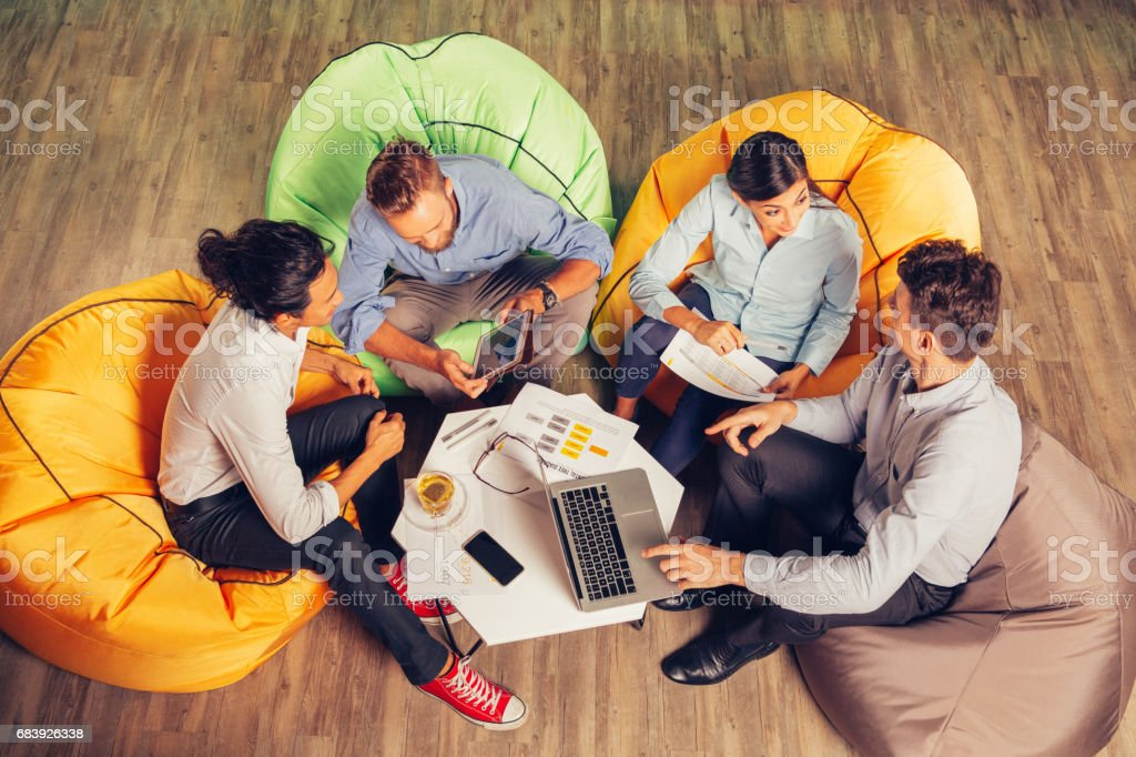 People Discussing Ideas and Sitting at Cafe Table stock photo