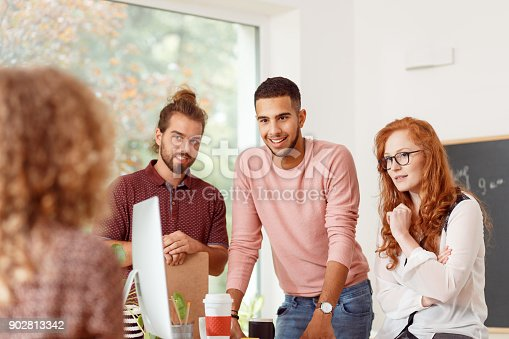 842214626 istock photo People discussing with team lead 902813342
