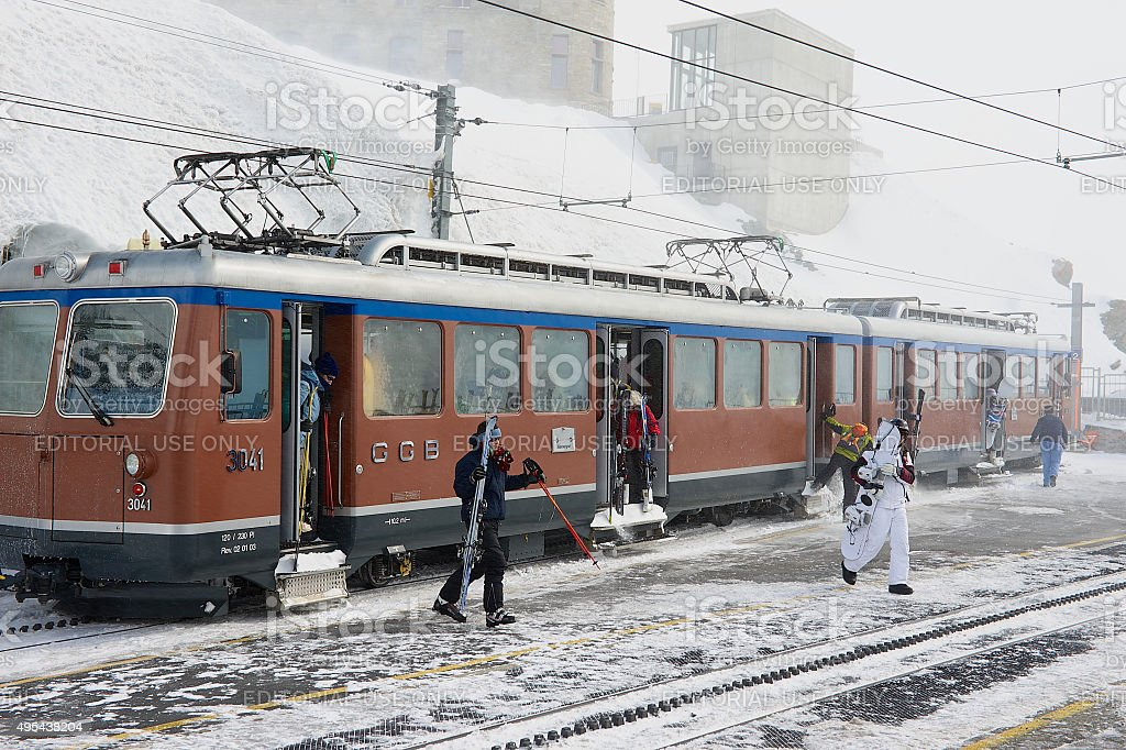 People disembark from the train in Zermatt, Switzerland. stock photo
