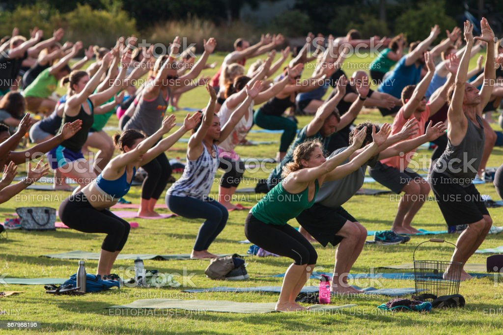 People Do Utkatasana Pose In Outdoor Group Yoga Class Stock Photo Download Image Now Istock