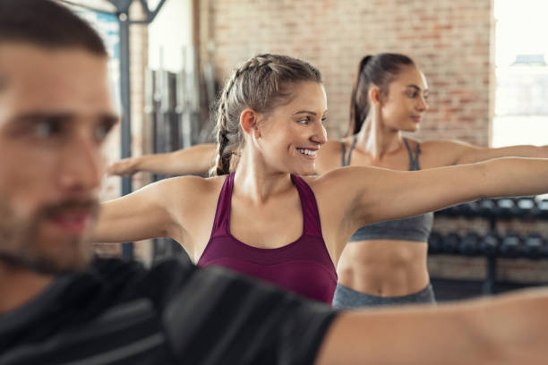 people doing aerobic exercise - class стоковые фото и изображения