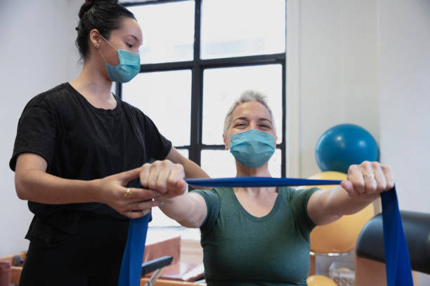 people doing exercise At rehab center wearing mask