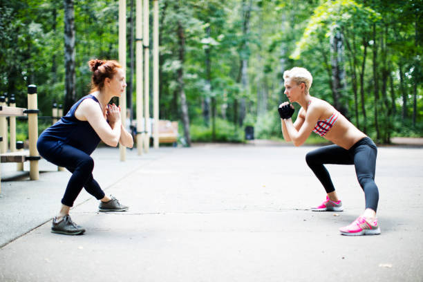 People doing exercise outdoors stock photo