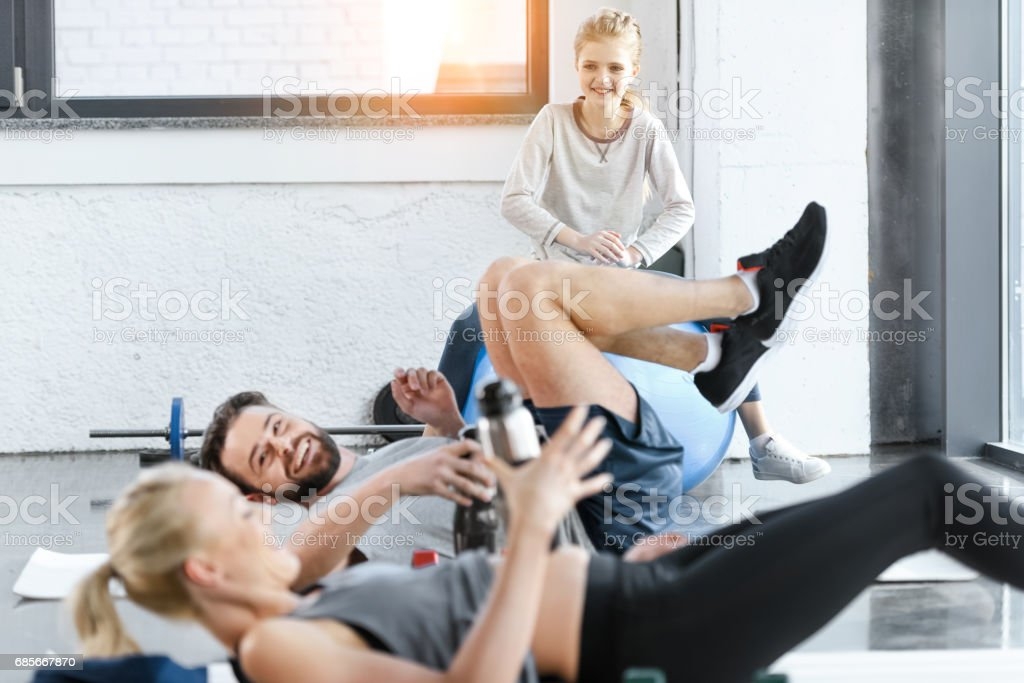 People doing gymnastics at fitness studio stock photo