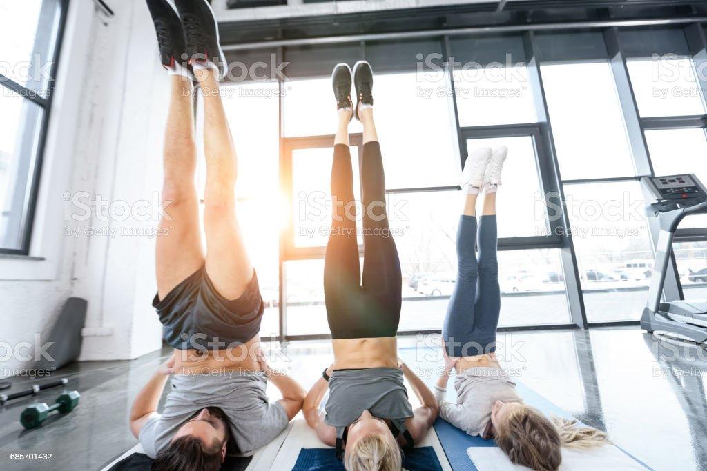 People doing gymnastics at fitness studio 免版稅 stock photo