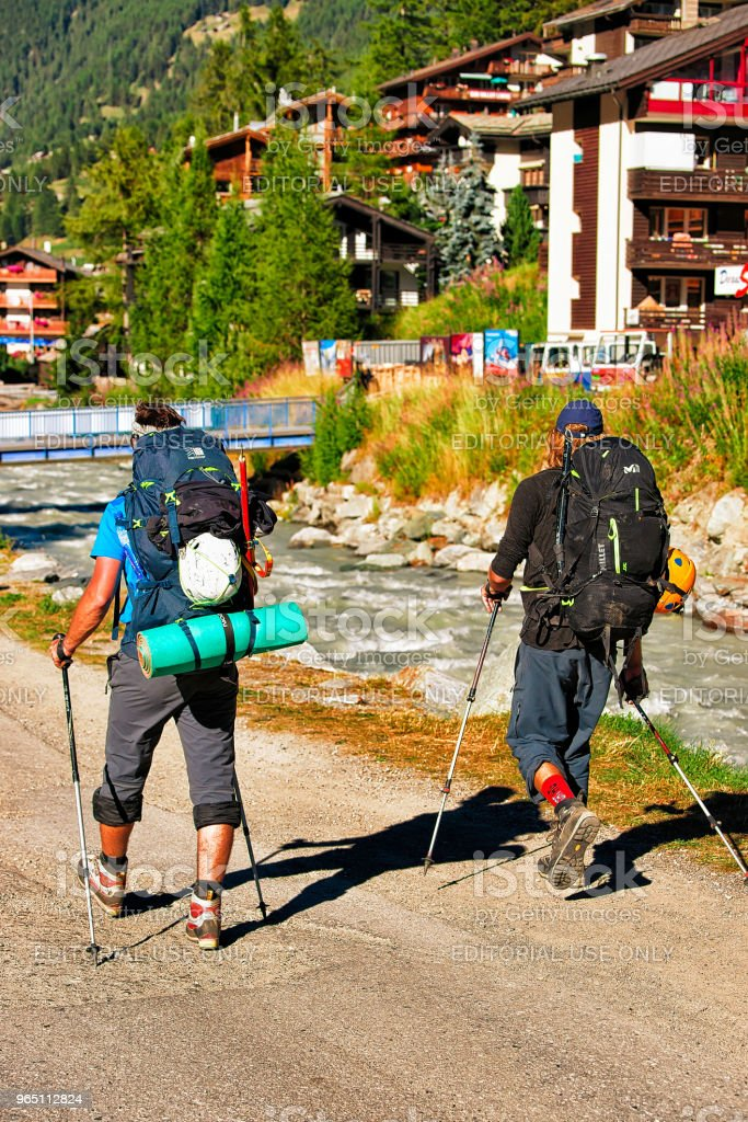 People doing nordic walking in resort city Zermatt CH royalty-free stock photo