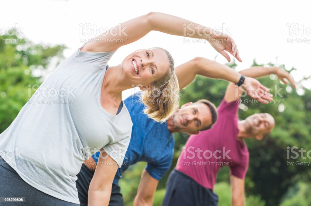 People doing stretching exercise royalty-free stock photo