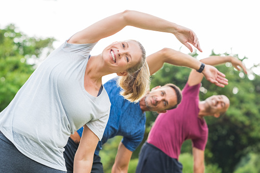 istock People doing stretching exercise 658596808
