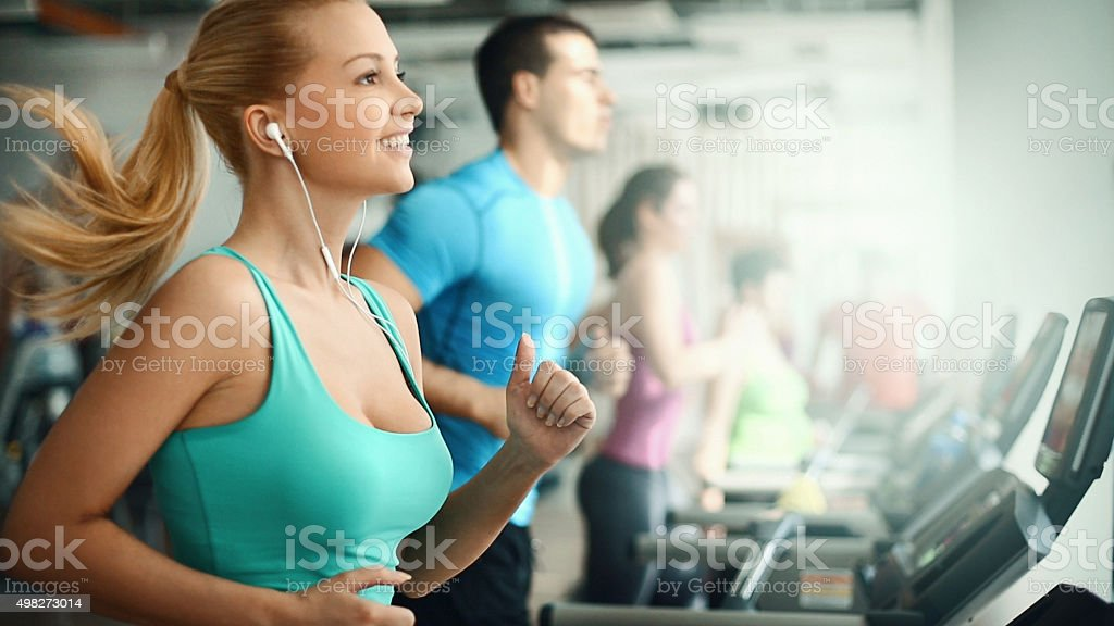 People doing treadmill exercise in a gym, stock photo