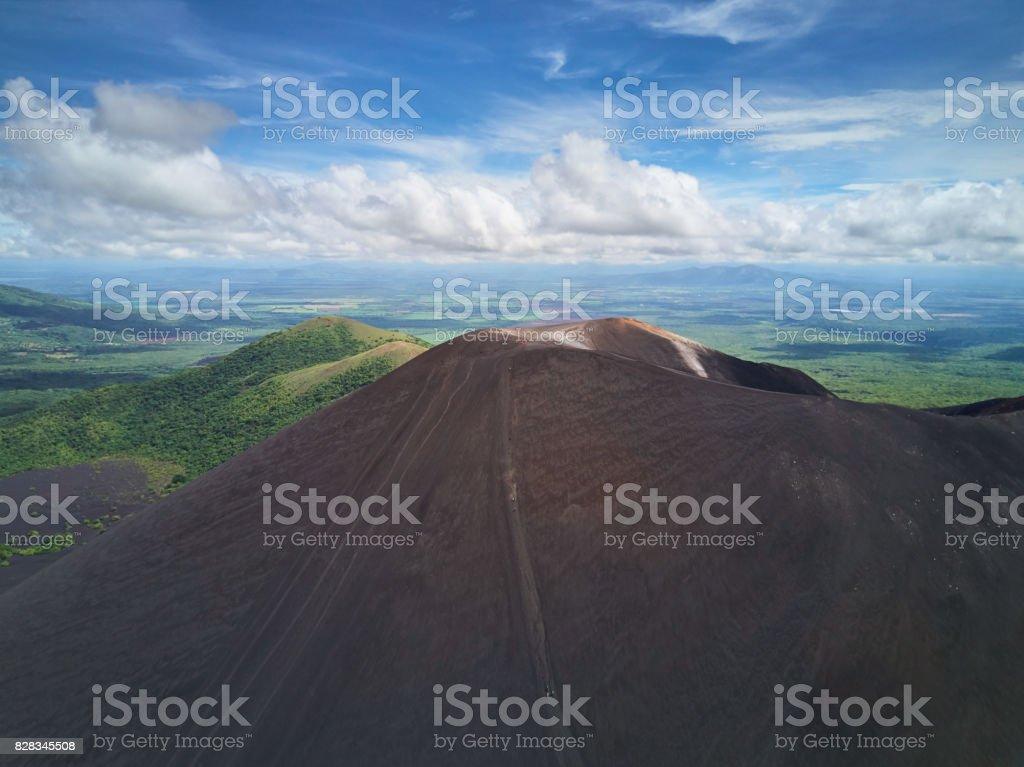 People doing volcano boarding stock photo
