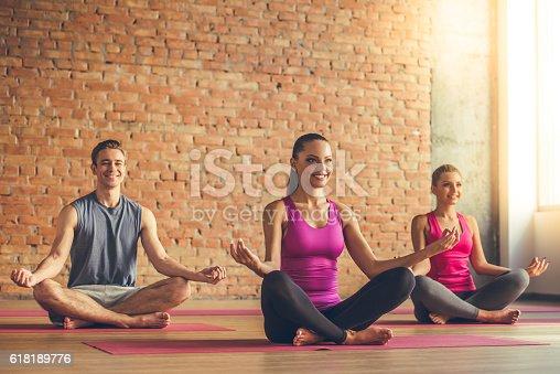 istock People doing yoga 618189776
