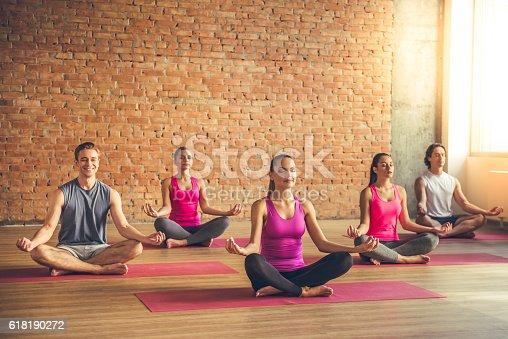 istock People doing yoga 618190272