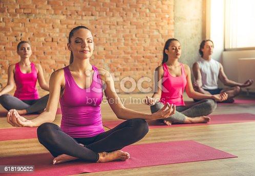 istock People doing yoga 618190522