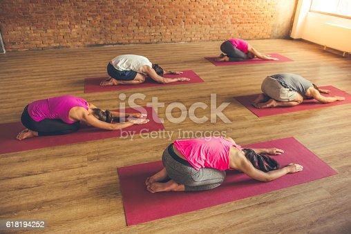 istock People doing yoga 618194252