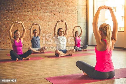 istock People doing yoga 618194658