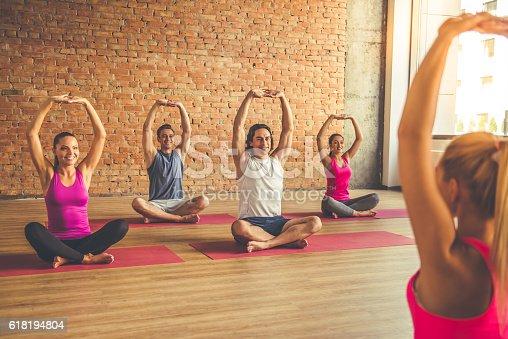 istock People doing yoga 618194804