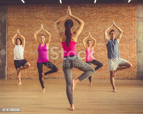 istock People doing yoga 618196036