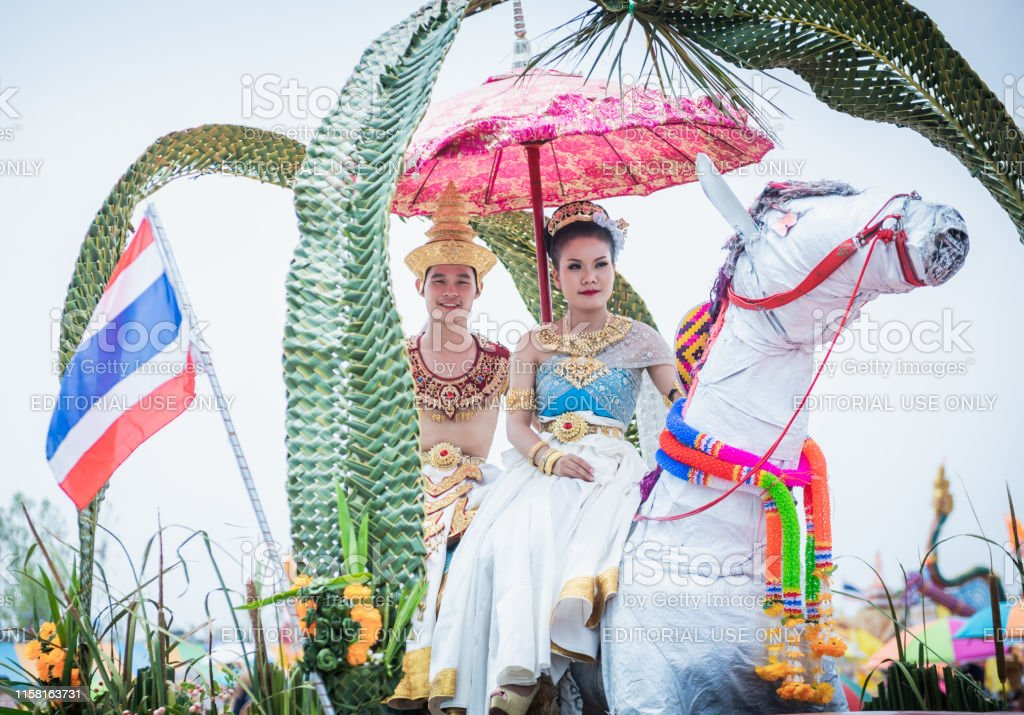 People dress up the characters in the novel walking at the parade of...