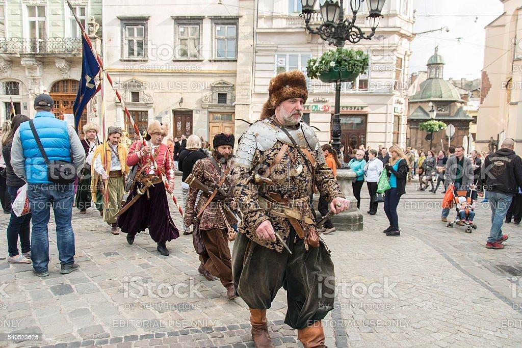 People dressed as Ukrainian Cossacks on square Rynok, Lviv, Ukraine. stock photo