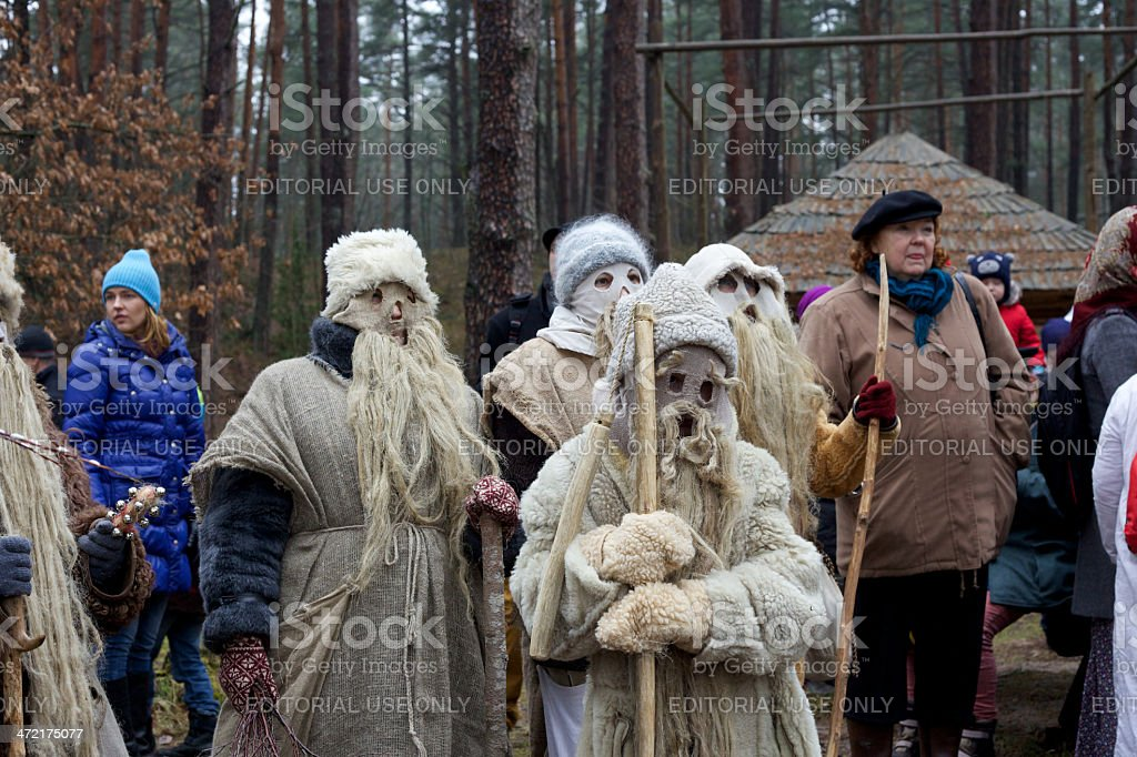 People dressed for Meteni festival with sticks stock photo