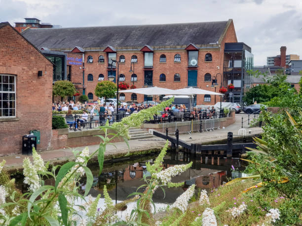 People drinking and dining at a restaurant in Castlefield district in Manchester stock photo