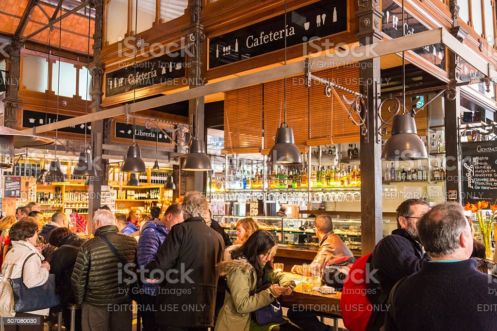 People drinking and eating at San Miguel market, Madrid. stock photo