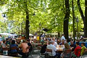 Munich, Germany - August 10, 2014: People drinking at the Augustiner Biergarten, one of the biggest and most traditional biergarten in Munich and popular with locals as well tourists.