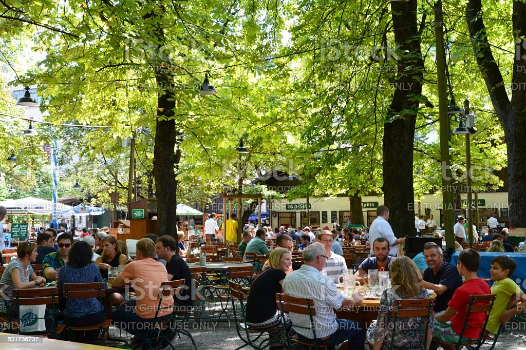 People drinking at a Biergarten in Munich, Germany stock photo