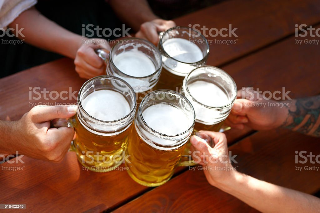 People drinking beer in a traditional Bavarian beer garden stock photo