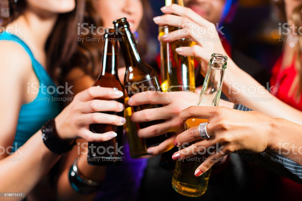 People drinking beer in bar or club stock photo