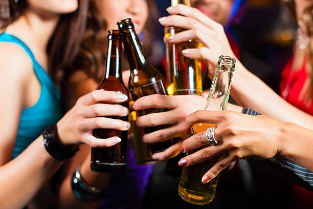 people drinking beer in bar or club - beer alcohol stock pictures, royalty-free photos & images