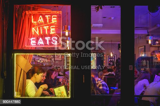 1140718043 istock photo People drinking cocktails in a club in Soho, London (UK). 930447880