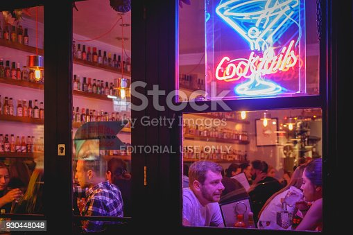 1140718043 istock photo People drinking cocktails in a club in Soho, London (UK). 930448048