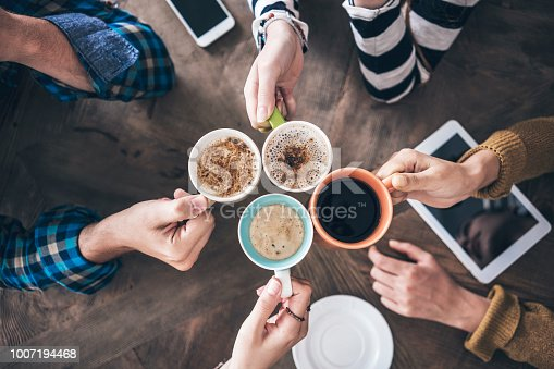 istock People drinking coffee high angle view 1007194468
