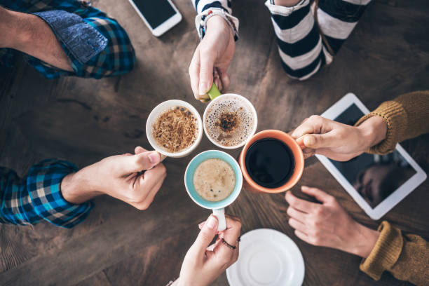People drinking coffee high angle view People drinking coffee high angle view caffeine stock pictures, royalty-free photos & images