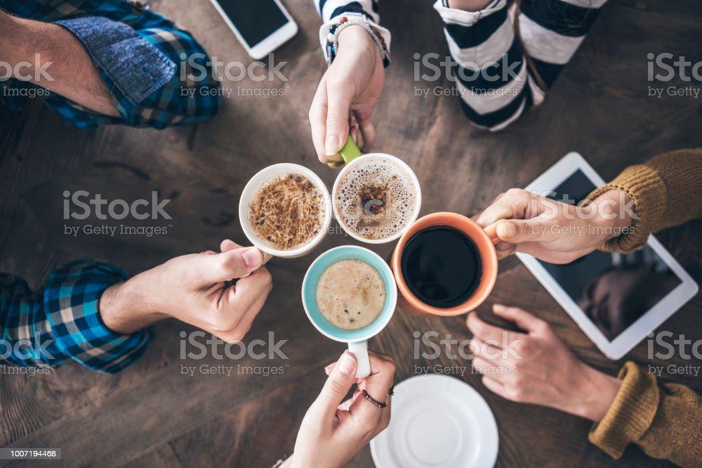 People drinking coffee high angle view stock photo
