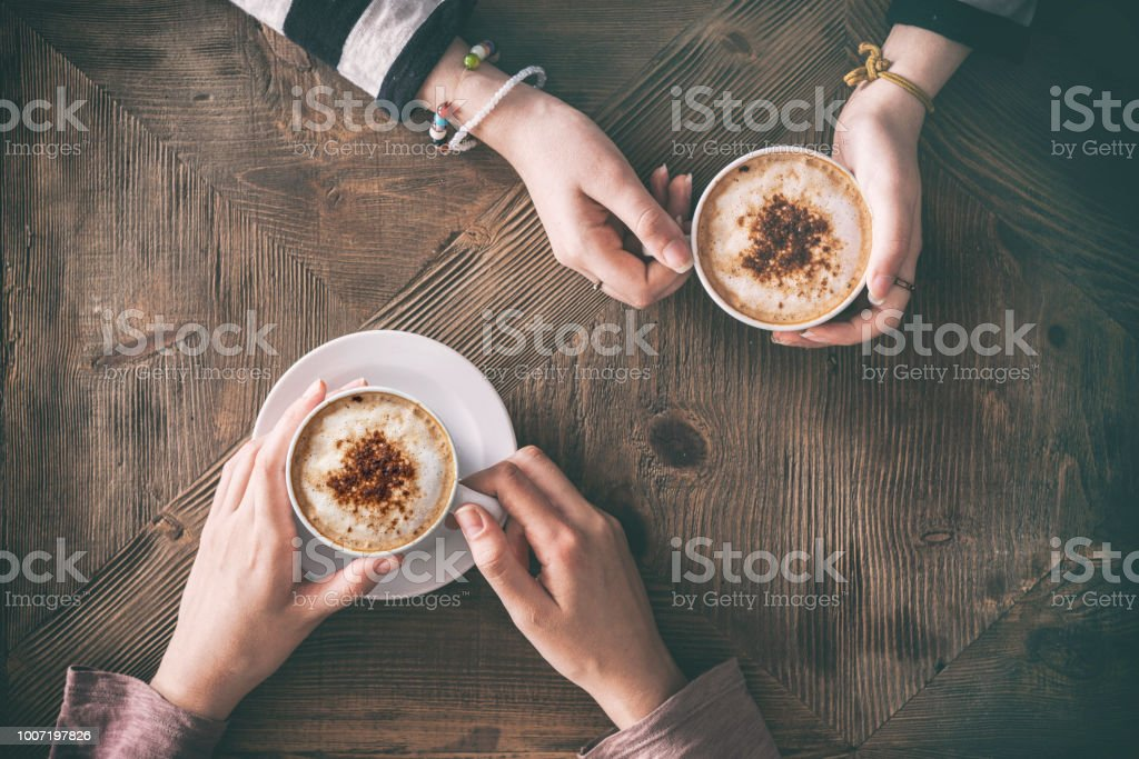 People drinking coffee high angle view royalty-free stock photo