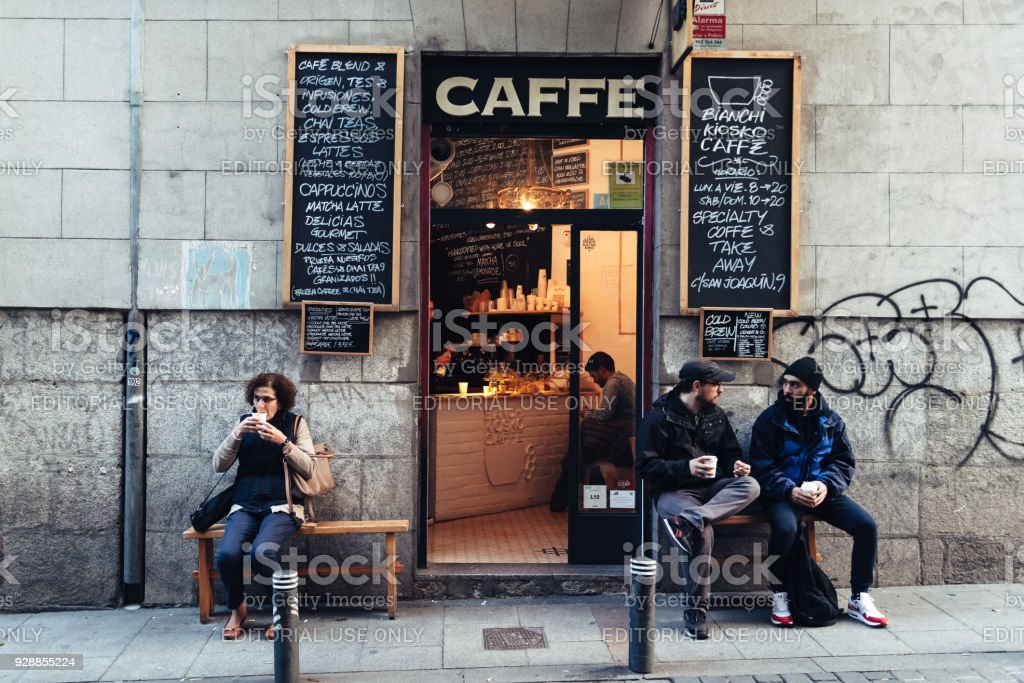 People drinking coffee outside hipster cafe in Malasana distric stock photo