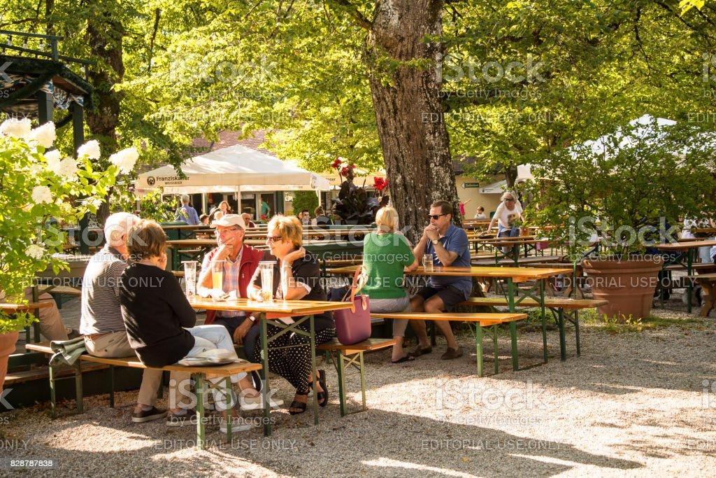 People drinking in a bavarian biergarten stock photo