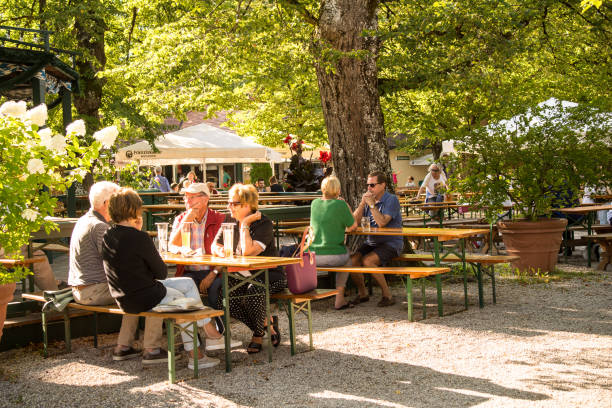 People drinking in a bavarian biergarten stock photo
