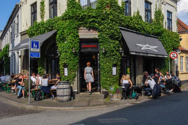People drinking on a street bar of Aarhus on Denmark stock photo