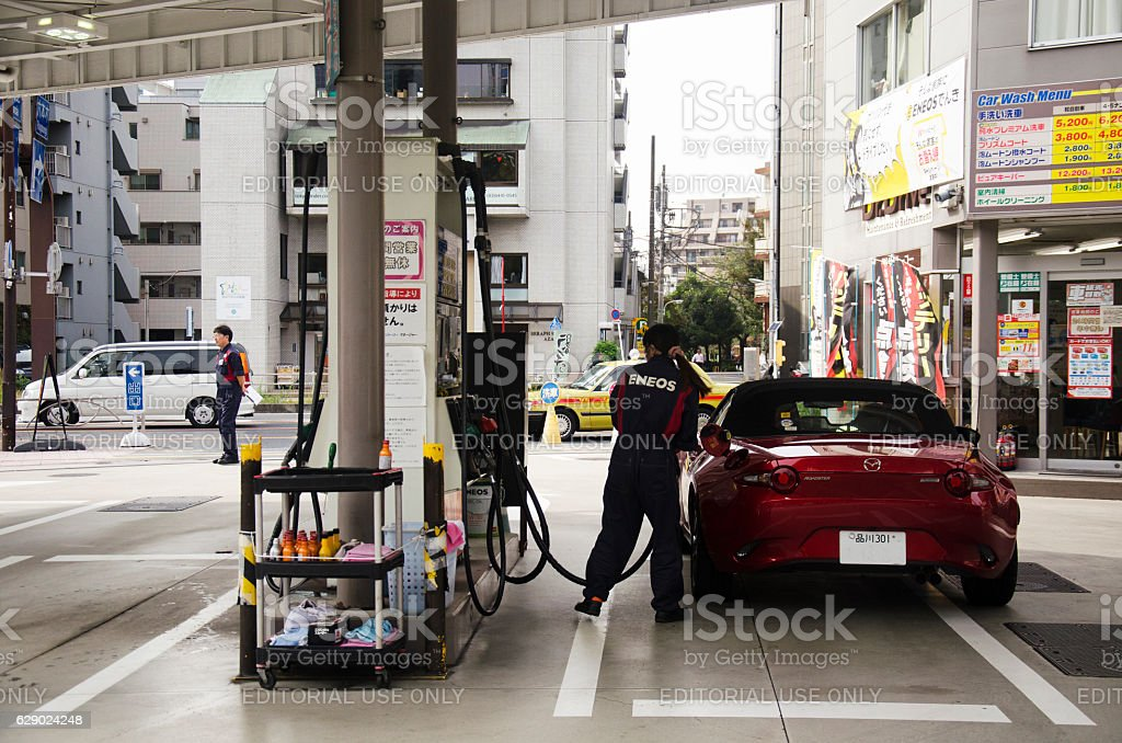 People drive car go to fill oil in petrol station stock photo