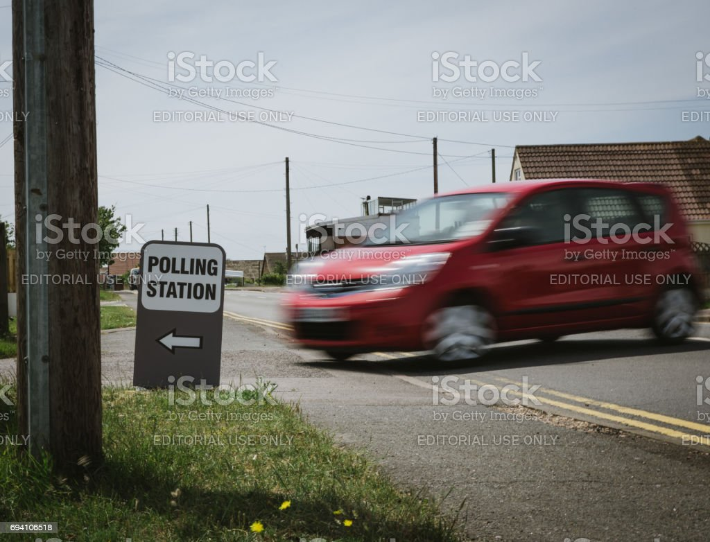 People drive into polling staion stock photo