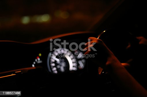 157590217 istock photo people driving car on night road, traffic jam in the city 1188527466