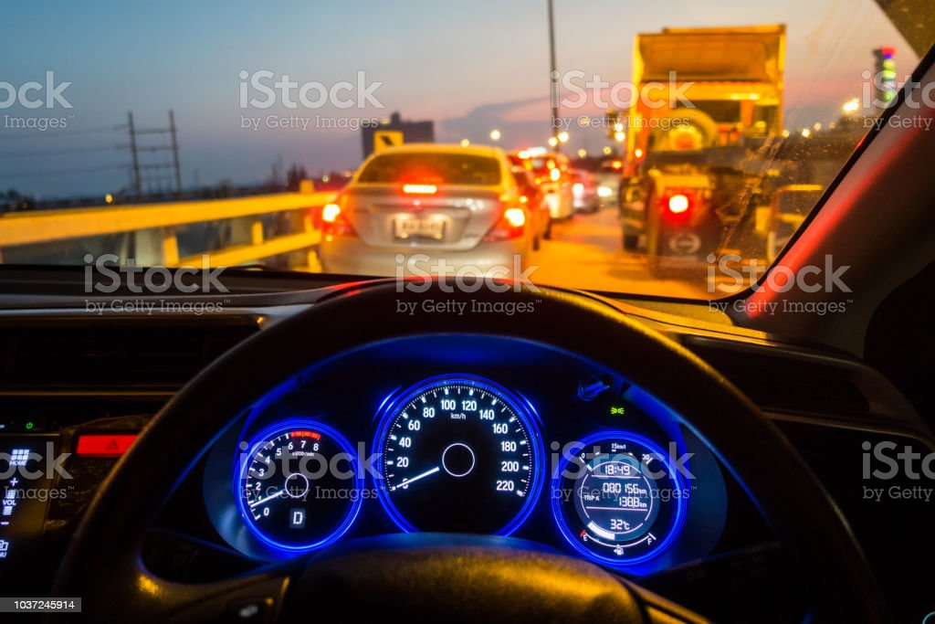 People Driving Car On The Traffic Jam At Night Stock Photo