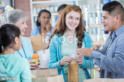 istock People drop off donated items at local food bank 827810158