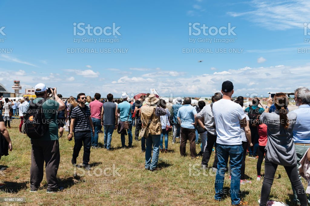 People during air show of historic aircraft stock photo