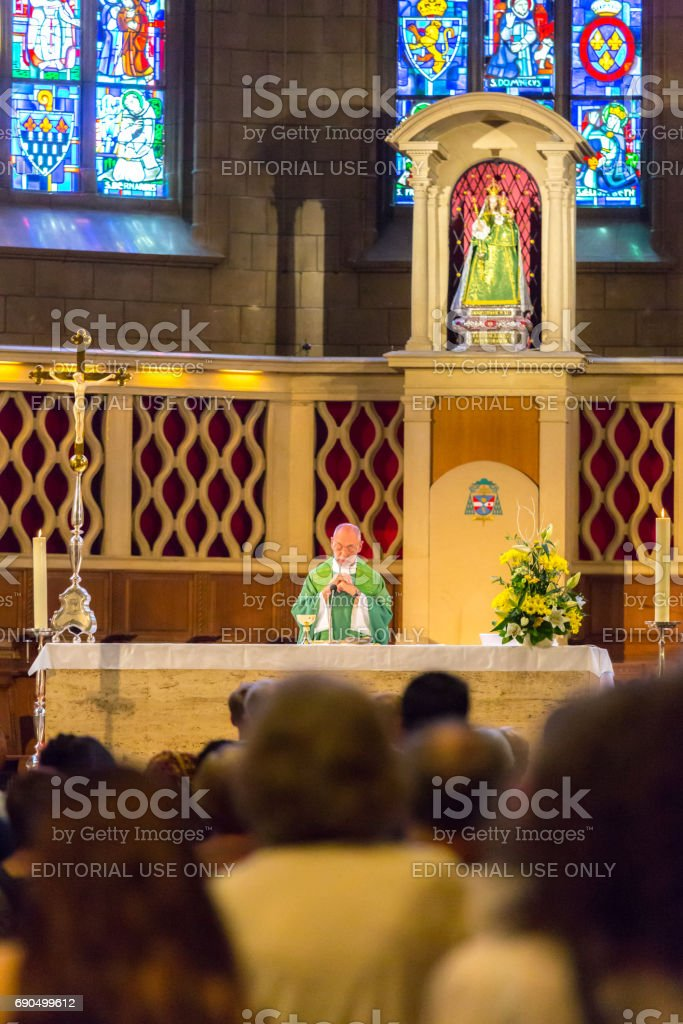 People during mass in Saint Michael's Church stock photo